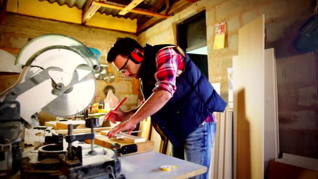 Cutting wood on a circular saw machine. video