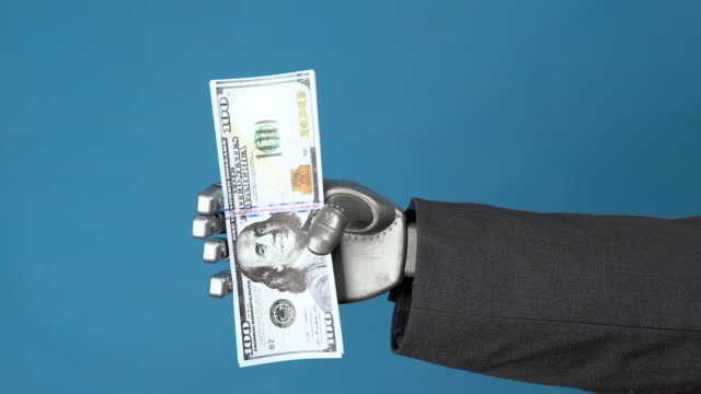 Cyborg businessman in a suit holds a pack of dollars. A mechanical hand shows a bundle of money on a blue background