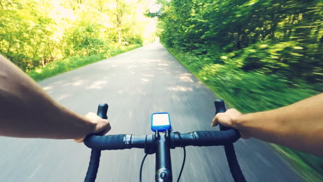 Cycling a race bike in a beautiful summer day. video
