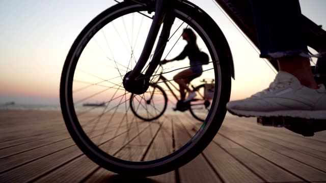 Cycling by the sea Low section of unrecognizable person riding a bike. biking stock videos & royalty-free footage