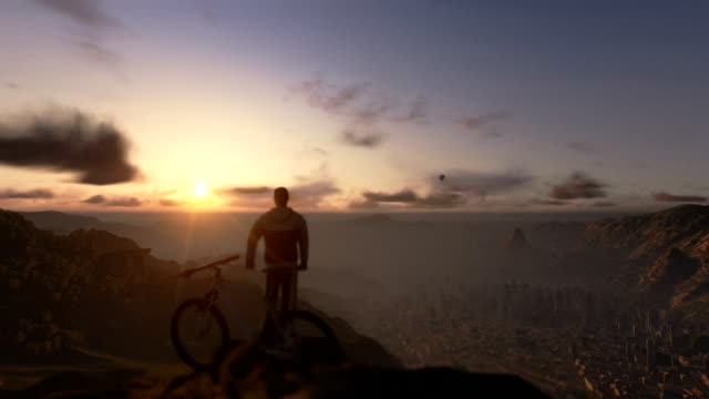 Cyclist on top of the mountain, timelapse sunset, fly over video