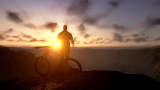 Cyclist on top of the mountain, timelapse sunset, tilt up video