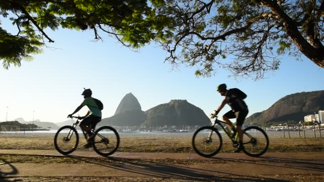 Cyclists in Front of the Sugarloaf Mountain in the Morning