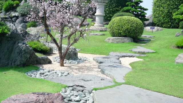 Cypresses emerge to stone bridge garden architecture in Vietnam