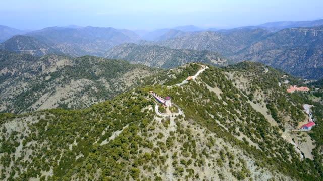 stockvideo's en b-roll-footage met cyprus. cedar valley. de kerk, een klooster in de bergen. toeristische attracties cederhout. pijnboompitten - klooster