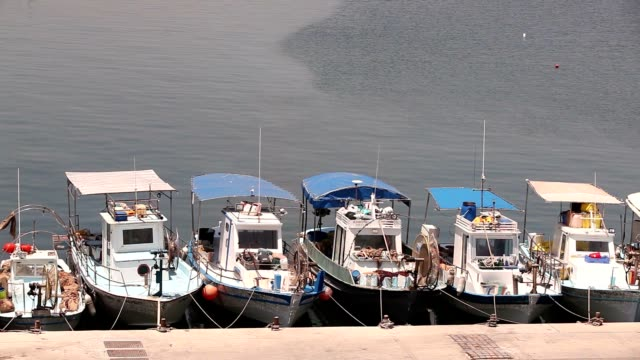 Cyprus, Greece, Pleasure boats and fishing boats in harbor, fishing boats near the pier, boat parking, A number of fishing boats park near the pier in the port, Panorama, top view, tourism video