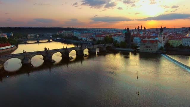 Czech Republic Prague Aerial Flying low around Charles Bridge with cityscape views