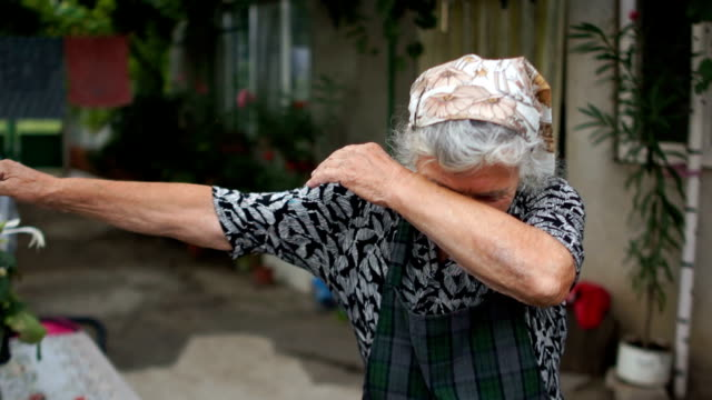 Dab is dancing a retired woman in the village. An elderly woman shows a modern youth movement. Dabing