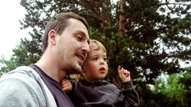 Dad and baby are looking at sky