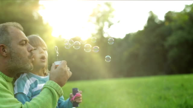 Dad and daughter blowing bubbles video