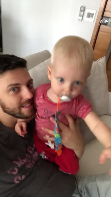 dad and son on a video call at home - вертикальный стоковые видео и кадры b-roll