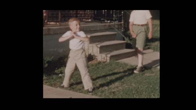 1956 Dad and Son play baseball in front yard video