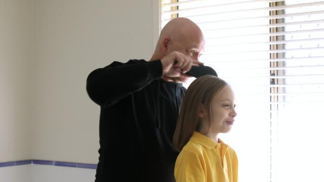 Dad Brushing Daughter's Hair