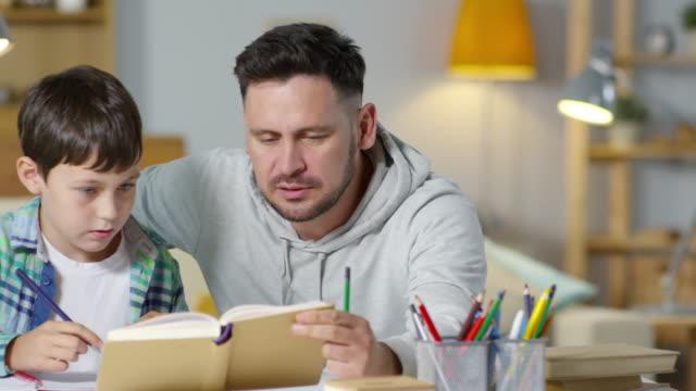 Dad Helping Kid with Homework