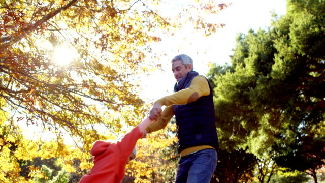 Dad spinning daughter around outdoors video