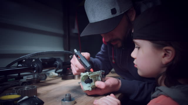 4k Dad Teaching Son How To Work With Glue And Tools Stock