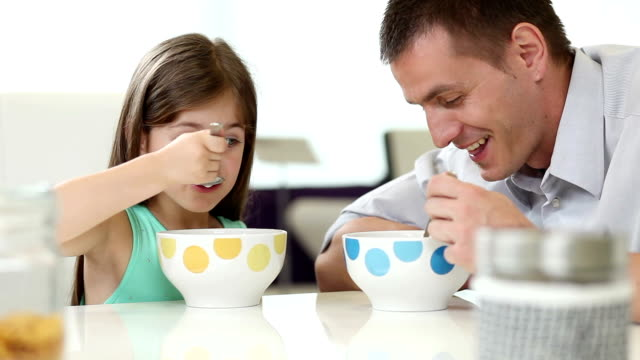 Daddy and daughter having breakfast video