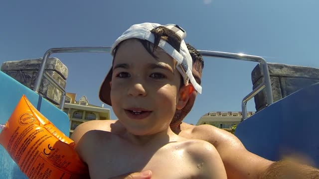 Daddy And Son Slow Motion Water Slide Shot video