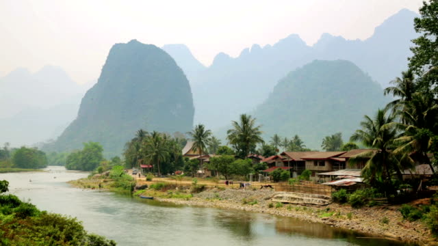 Daily life of Vang Vieng village with limestone mountains, Laos video
