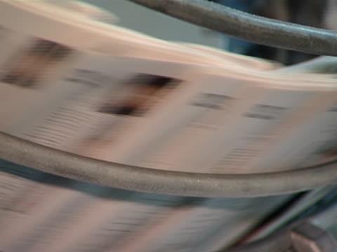 daily printing equipment for newspapers printing-house. - paper mass bildbanksvideor och videomaterial från bakom kulisserna