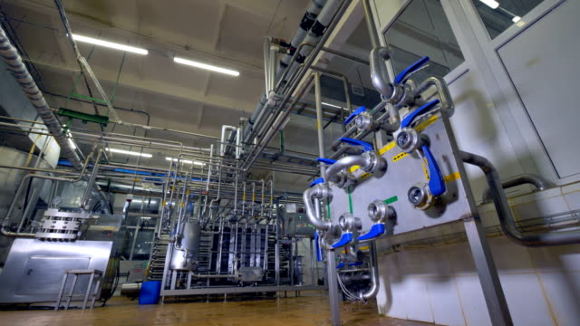 A dairy factory piping system with a control unit. video