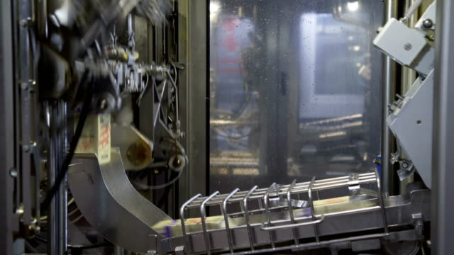 Dairy products in tetra packaging are moving along the conveyor at a dairy factory. Tetra baby food packaging - video