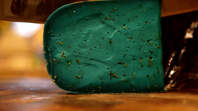 Dairy shop with exotic kinds of cheese: a piece of blue cheese is being cut video