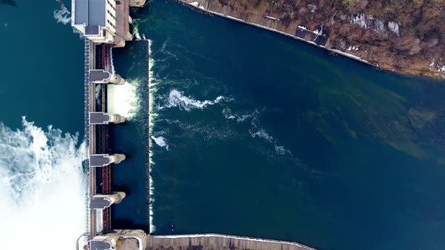 Dam and waterfalls on river. Top view. Aerial shot. video