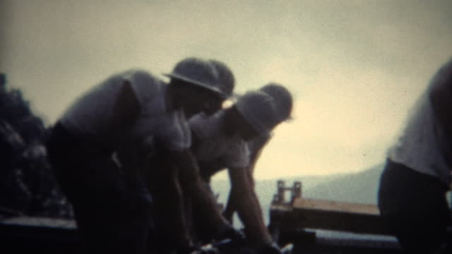 (8mm Film) Dam Concrete Workers 1954 A unique vintage 8mm home movie film professionally cleaned and captured in full 4k (3840x2160 UHD) resolution plus post processing including retro color correction, deinterlace, and deflicker. 20th century stock videos & royalty-free footage