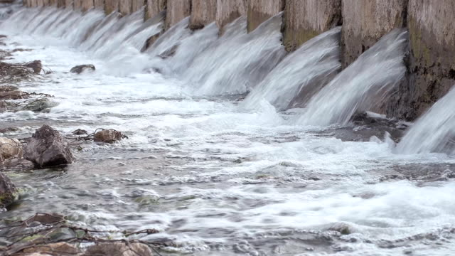 Dam is a dam overflowing with water a lot. As the water falls from a height. Enormous pressure of water to flow into the well. video