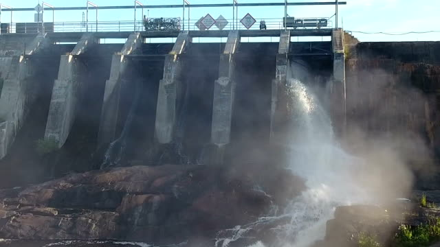 Dam on a river opening its flood gates video