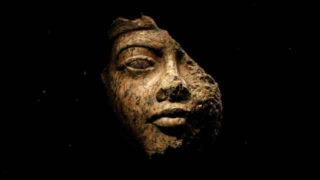damaged ancient face carving - antica civiltà video stock e b–roll