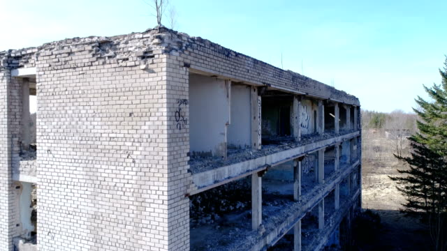 Damaged brick walls of the building from the war video