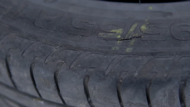 Damaged by a blow to the impact hole, a tire ejected, discarded