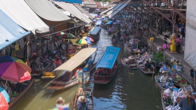Damnoen Saduak, the most famous traditional floating market and cultural tourist destination, Ratchaburi, Thailand; tilt down - Time-lapse