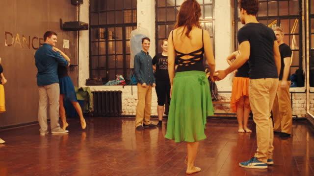 Dance classes. Dance teacher showing dance moves. video