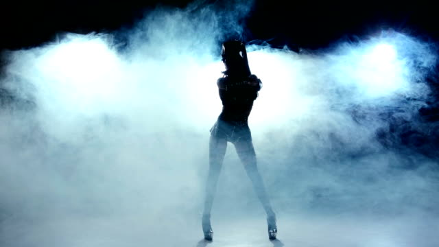 Dance of beautiful sexy girl in erotic black suit clothes, smoke video