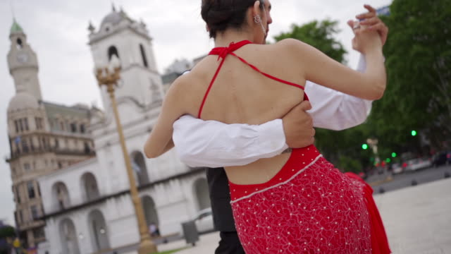 Dance partners performing tango argentino outdoors