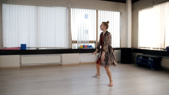 Dance rehearsal in the dance hall. Female dancer practicing before the performance in the rehearsal room. Woman Dancer in dress trains dance in front of the mirror in the ballroom. leotard stock videos & royalty-free footage