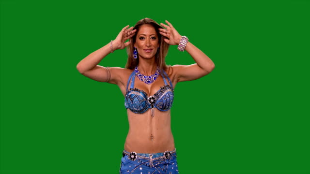 Dancer. Belly dance. Belly dancer dancing. Green screen. Blue sexy dress video