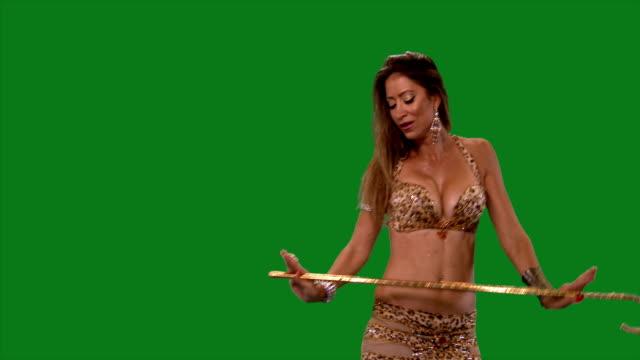 Dancer. Belly dance. Belly dancer dancing. Green screen. mottled sexy dress video