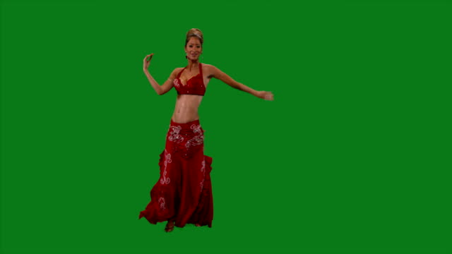 Dancer. Belly dance. Belly dancer dancing. Green screen. Sexy red dress video