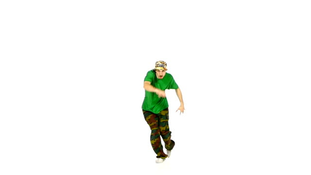 Dancer in green shirt starts dancing breakdance, makes movement, white, slow motion video