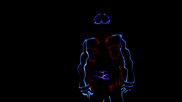 Dancer in LED costume on stage Dancer in a LED costume in a cap and glasses led light stock videos & royalty-free footage