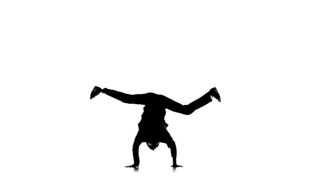 Dancer man dancing breakdance professionally moves, white, silhouette, slow motion video