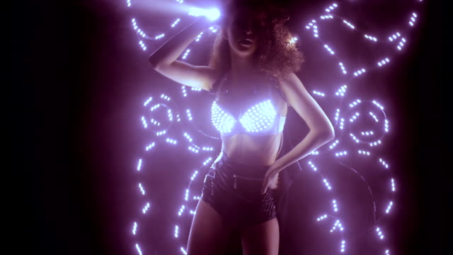 Dancer performing in led costume with butterfly wings video