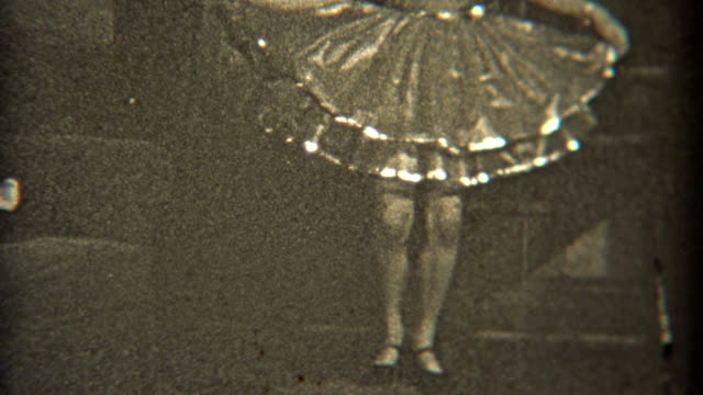 1936: Dancer practicing her craft indoors with fancy dress. video