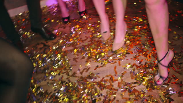 Dancing All Night Close-up of legs dancing on the floor covered with confetti dress shoe stock videos & royalty-free footage