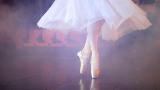 Dancing ballerinas feet in a fogged room. video