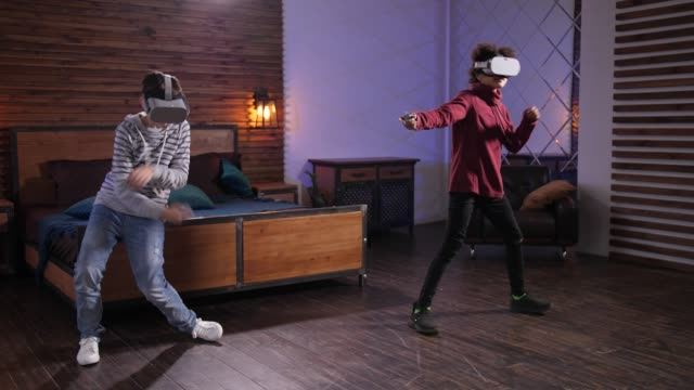 Dancing boys in VR glasses during domestic leisure